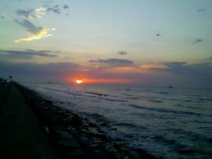 One of my all-time favorites - on an old cell phone (new at the time) as I ran along the beach in Galveston, Texas